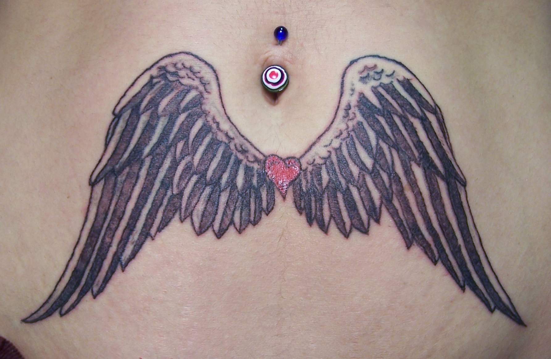 Cute Angel Wings Tattoos On Girl Stomach