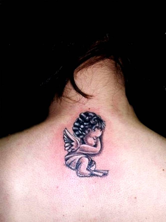 Cute and Small Baby Angel Tattoo on Upper back for men