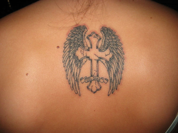 Small Angel wings with Cross tattoo on girl's upper back