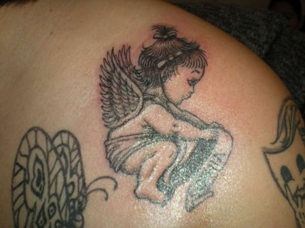 Small baby angel tattoo on back shoulder