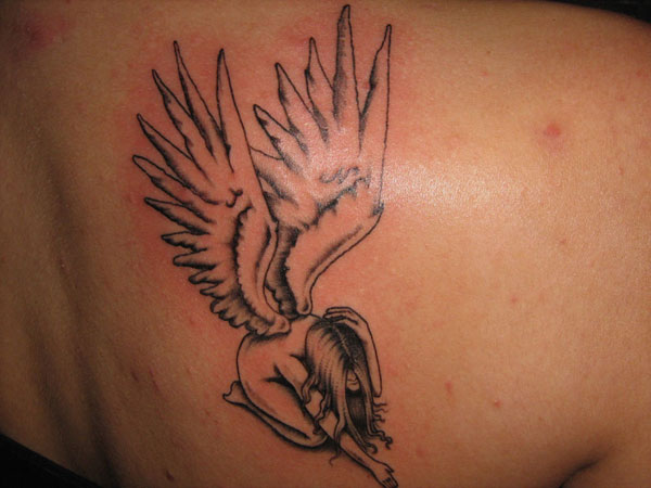 Small fallen angel tattoo on back shoulder