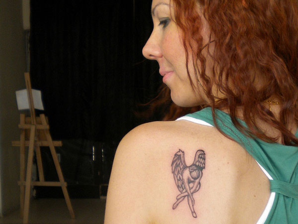 Tiny Fallen Angel Tattoo on Shoulder Back