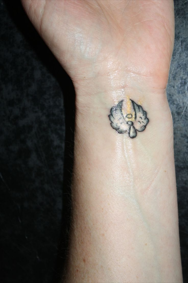 Tiny Flying Angel Tattoo on Wrist