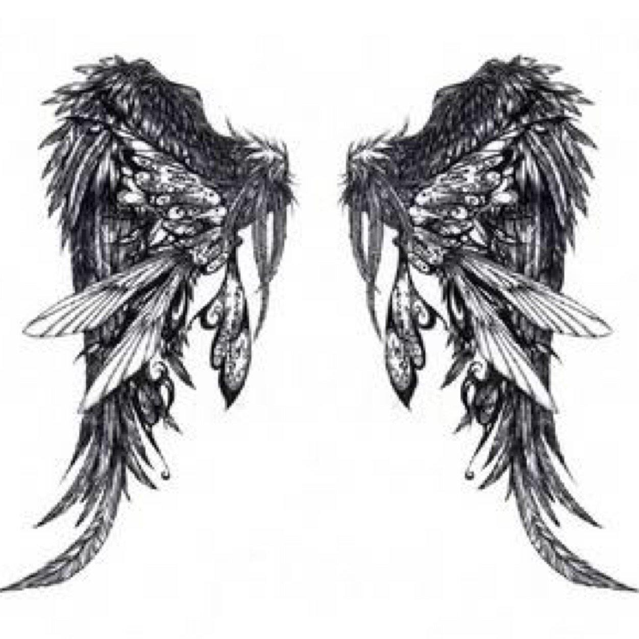 Unique Angel Wings Tattoo Design Idea