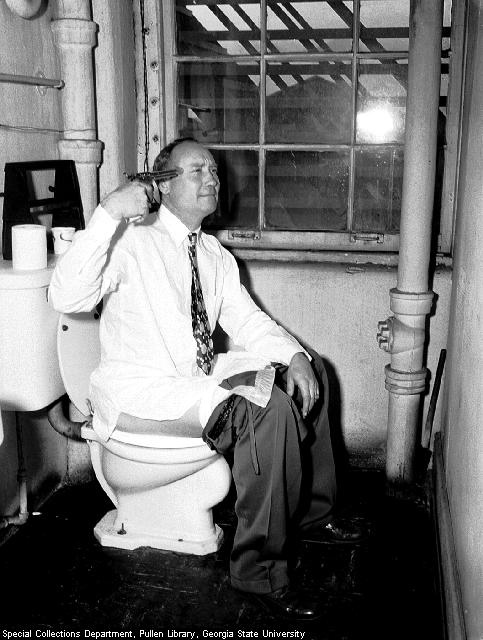 Man Sitting In Toilet And Trying To Shoot Himself Funny Vintage Image