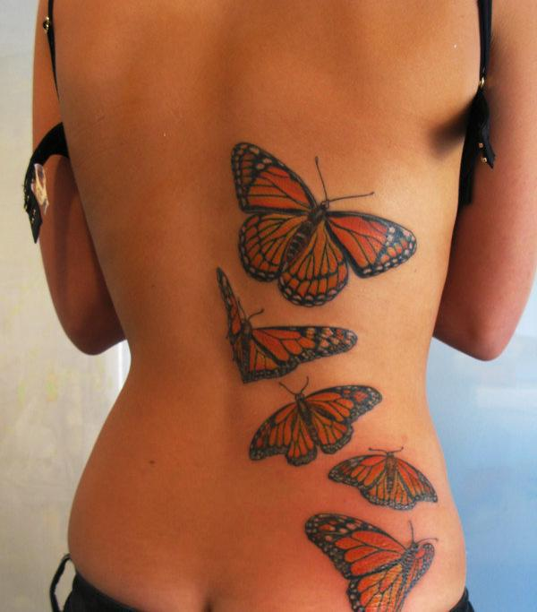 3D Flying orange butterflies tattoo on back