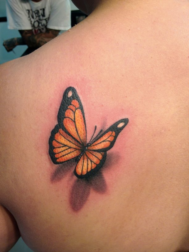 3D orange and black butterfly tattoo on back