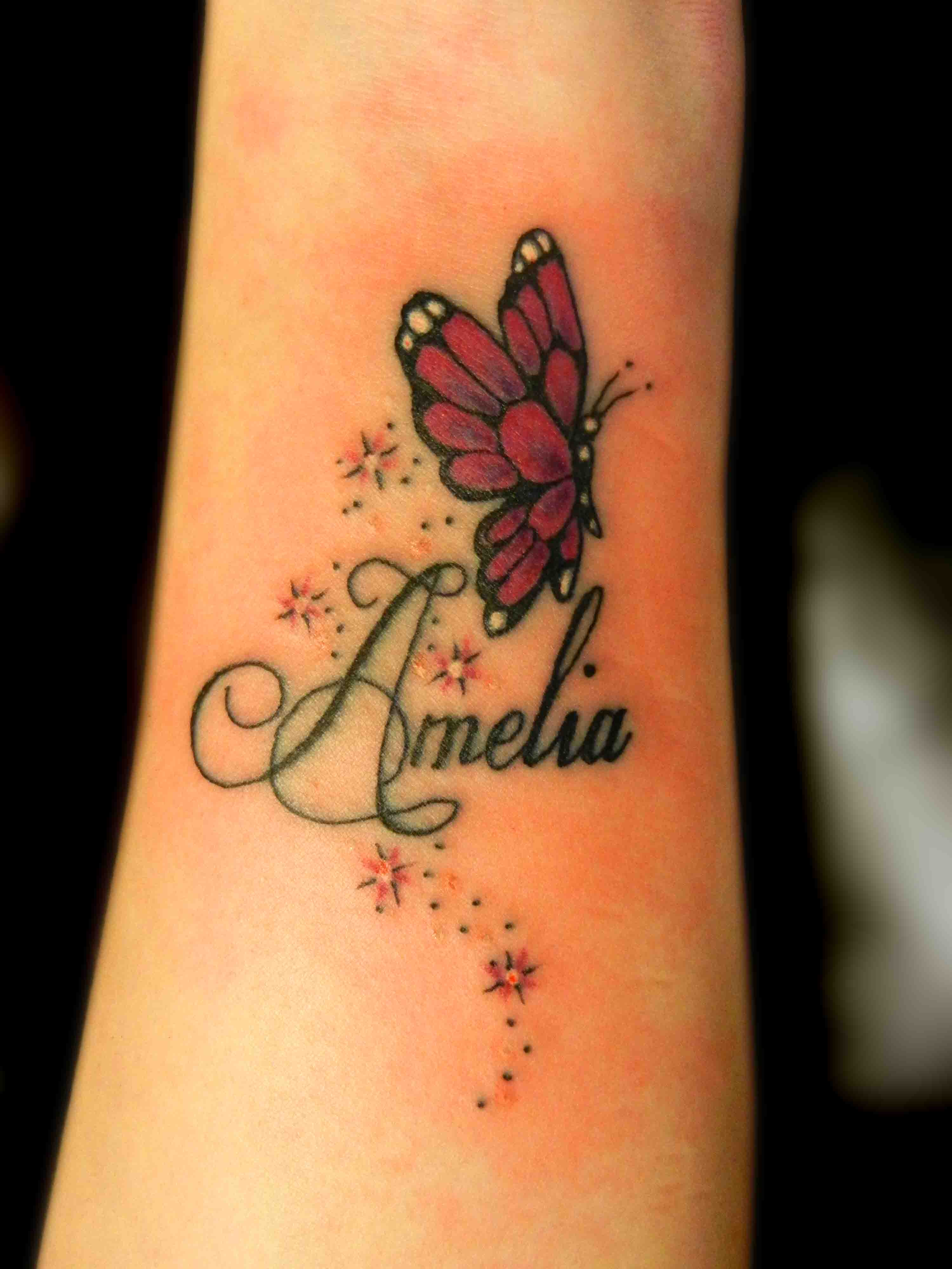 Tattoo ideas for the wrist - Amelia Name And Butterfly Tattoo On Wrist