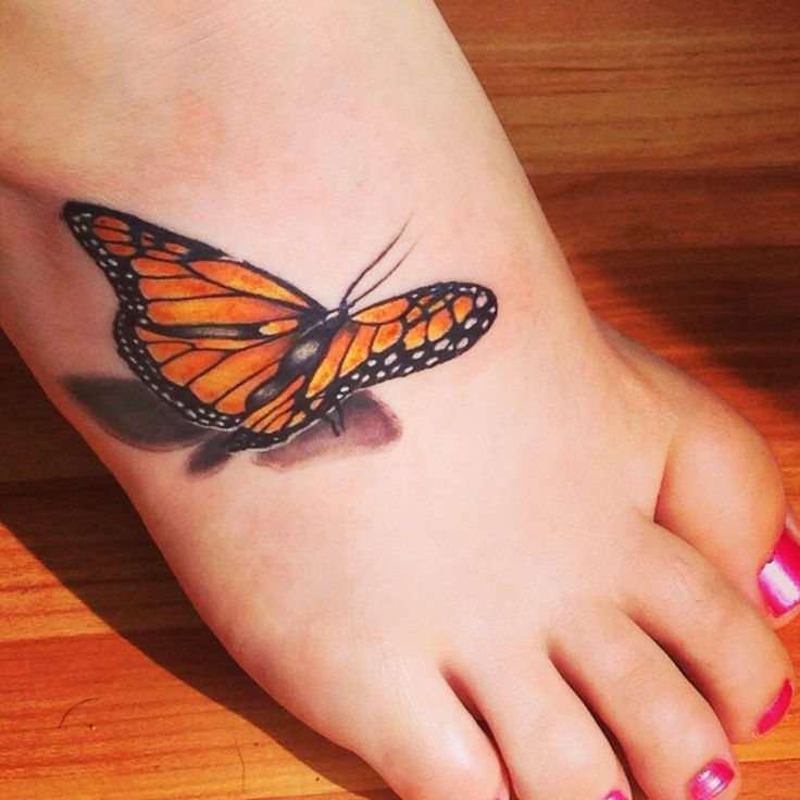 Realistic Black and orange 3D butterfly tattoo on foot