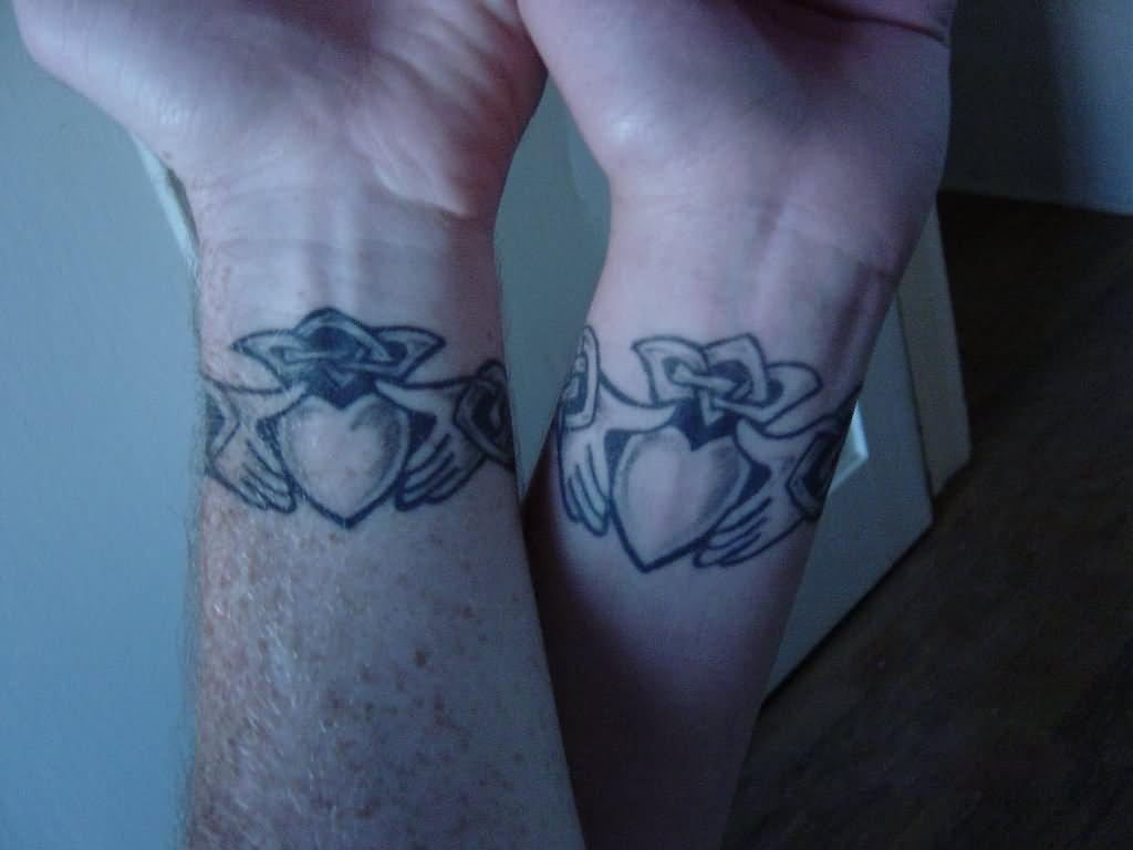 Black Celtic Cross Claddagh Tattoo On Man Right Back Shoulder