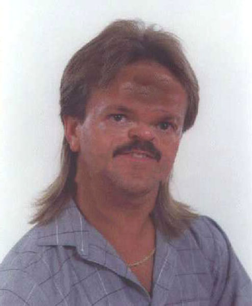 Funny face man with mullet hairstyle urmus Images