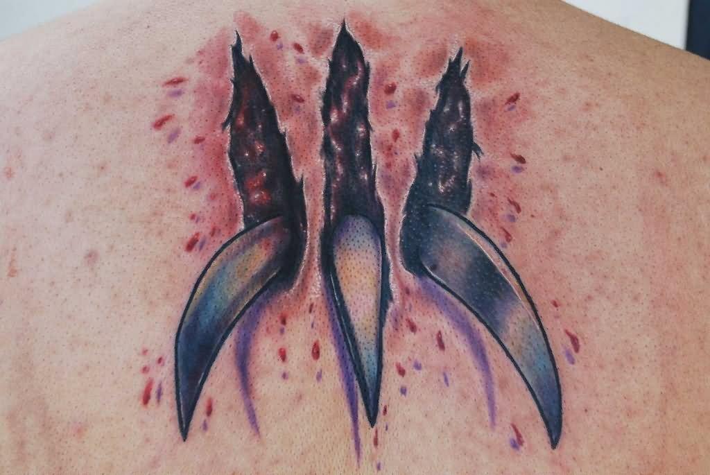 14 stunning wolverine tattoos ripped skin wolverine claw tattoo on upper back altavistaventures Choice Image