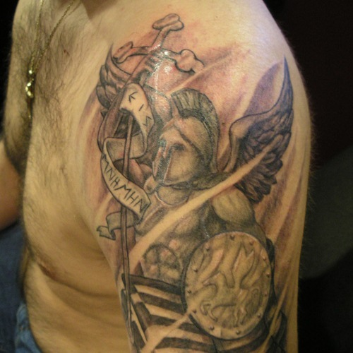 e415c2e3a48b4 Achilles With Cross And Banner Tattoo On Man Left Shoulder