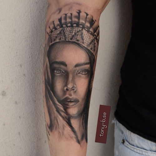 Amazing Achilles Girl Face Tattoo On Forearm