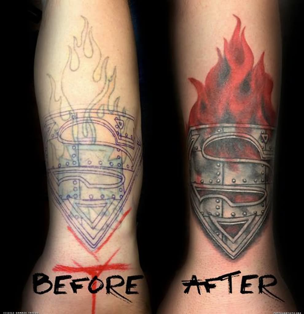 Amazing Superman Logo In Flame Tattoo Design For Forearm By Angela Grace