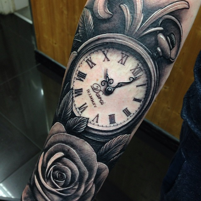 Amazing Black Ink Pocket Watch With Rose Tattoo Design For Forearm