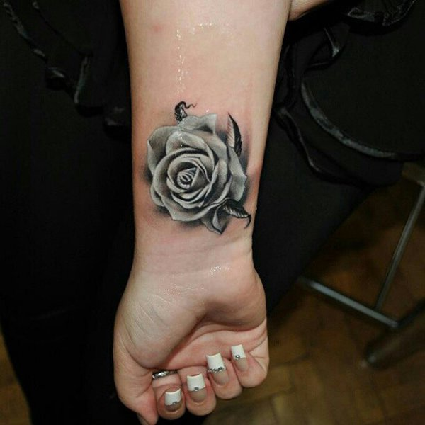 Beautiful Black And White Rose Flower Tattoo On Right Wrist