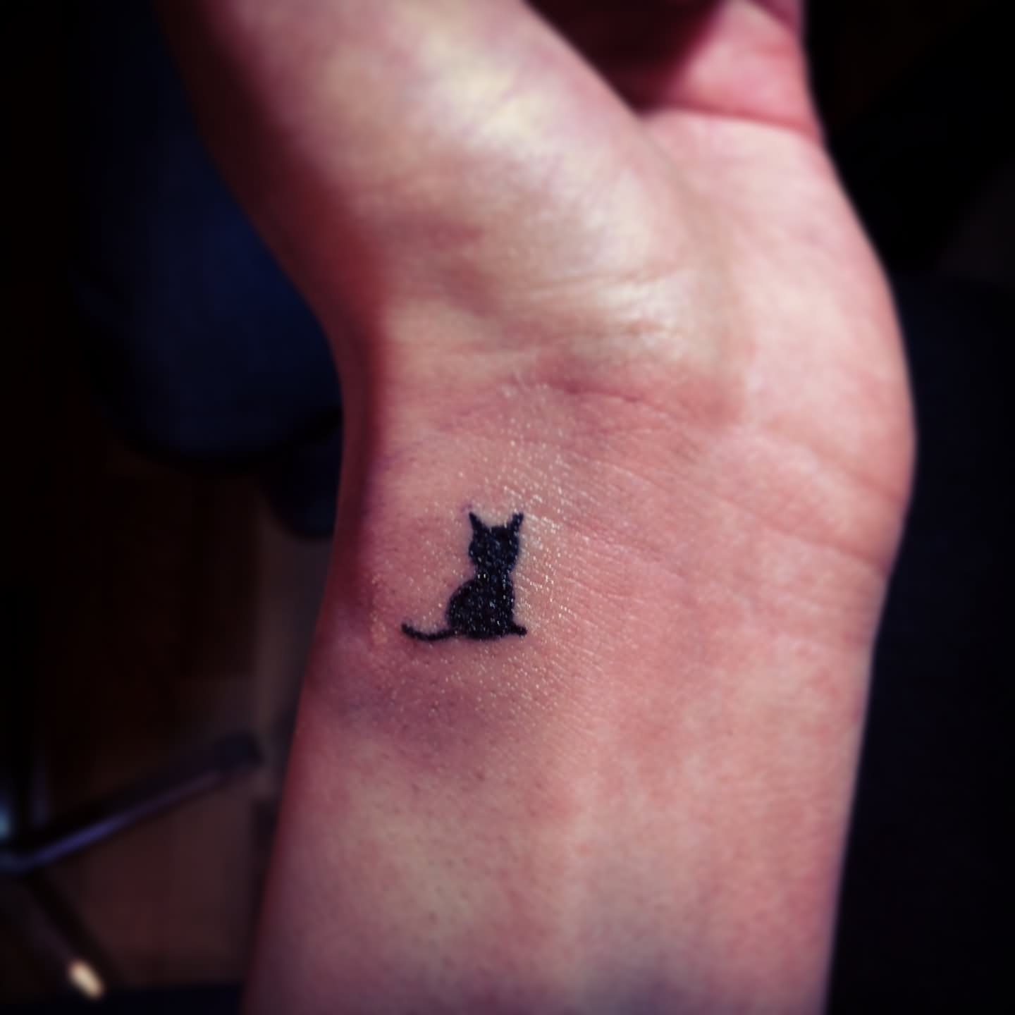 small cat silhouette on side wrist