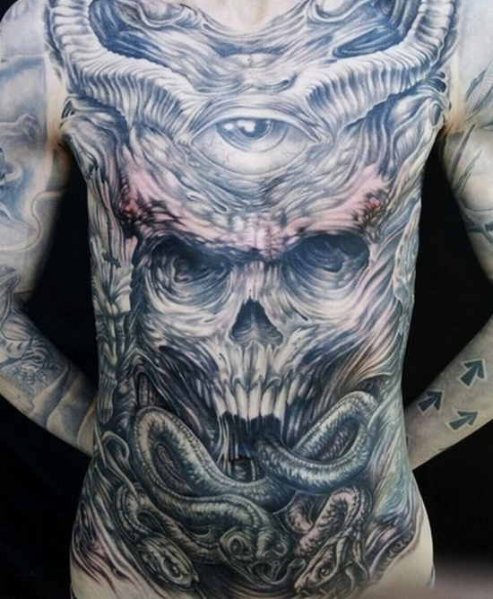 grey ink skull in demon hand tattoo on upper back by darin gonzales. Black Bedroom Furniture Sets. Home Design Ideas