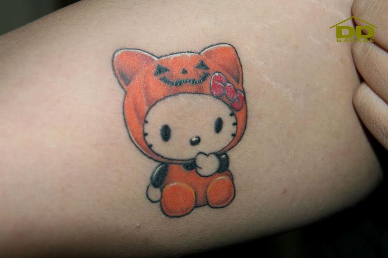 35 incredible halloween pumpkin tattoos for Pumpkin kitty designs