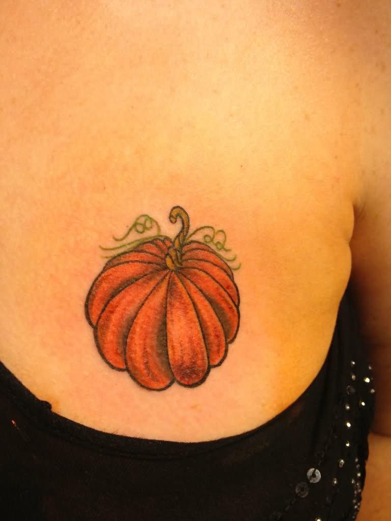 35 incredible halloween pumpkin tattoos for Tattoos of pumpkins