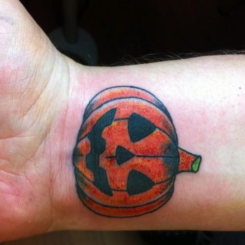 35 Incredible Halloween Pumpkin Tattoos