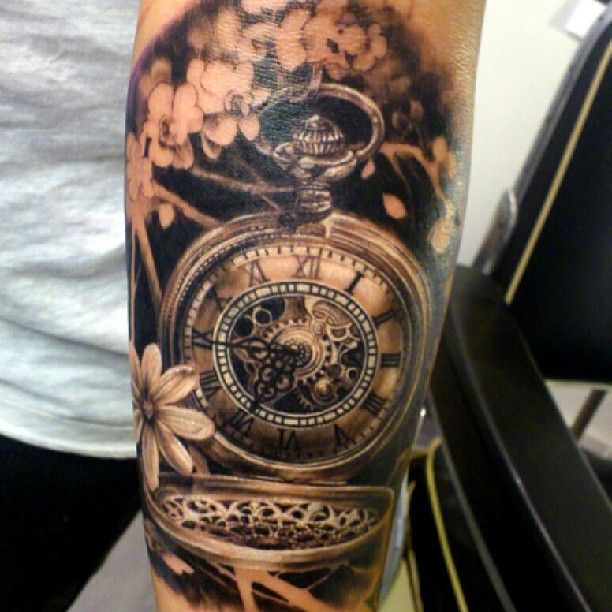 60a4dfb8fea97 Realistic Pocket Watch With Flowers Tattoo Design For Forearm