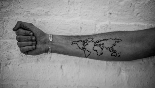 80 fantastic map tattoos black outline world map tattoo on forearm gumiabroncs Image collections