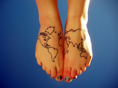 80 fantastic map tattoos black outline world map tattoo on girl feet gumiabroncs Choice Image