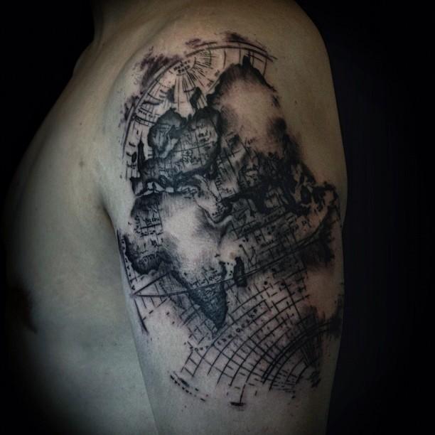 Delightful Fantastic Black Ink Map Tattoo On Left Shoulder