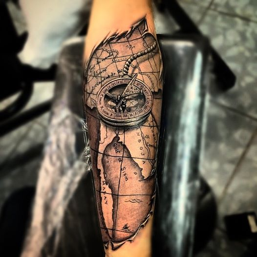 80 fantastic map tattoos ripped skin map with compass tattoo on forearm gumiabroncs Images