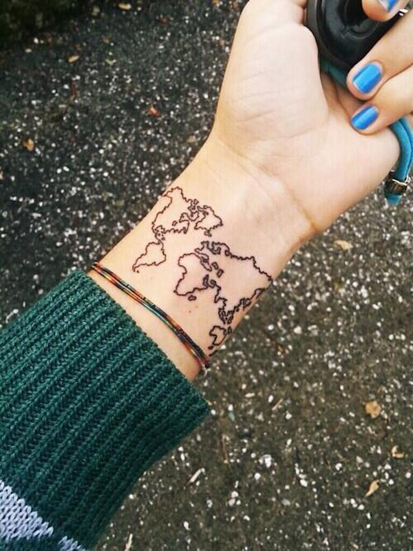 80 fantastic map tattoos simple black outline world map tattoo on girl wrist gumiabroncs Gallery