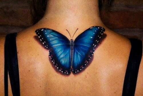 Black And Blue 3D Butterfly Tattoo On Upper Back