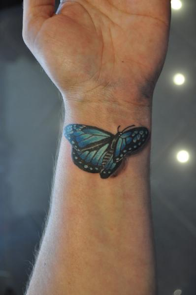 Black And Blue 3D Butterfly Tattoo On Wrist