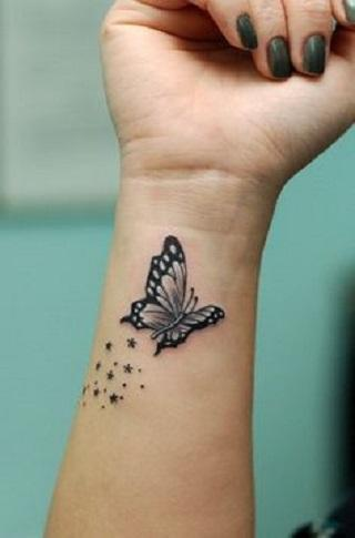 Black And Grey 3D Butterfly Tattoo On Girl Wrist