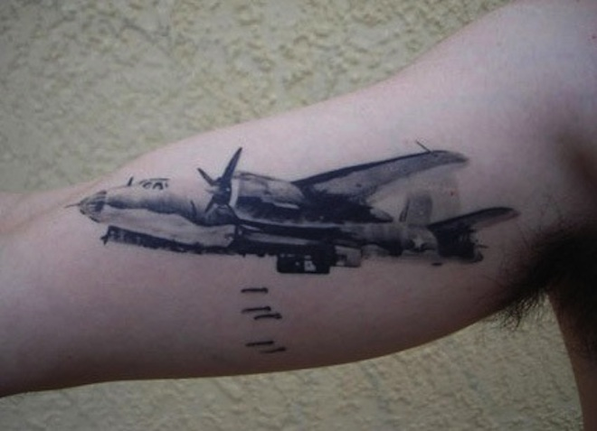 black and grey bomber airplane tattoo on bicep. Black Bedroom Furniture Sets. Home Design Ideas