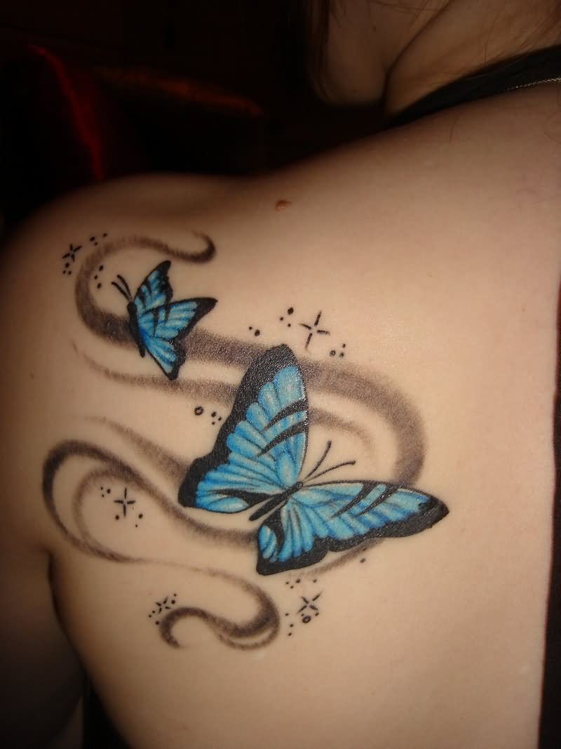 Blue And Black Two Flying Butterflies Tattoo On Left Back Shoulder