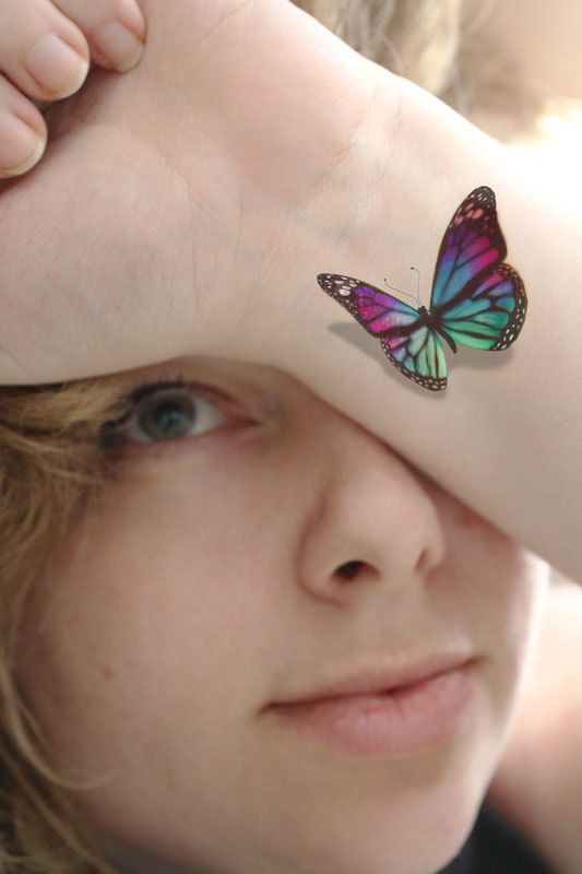 Colorful 3D Butterfly Tattoo On Girl Wrist