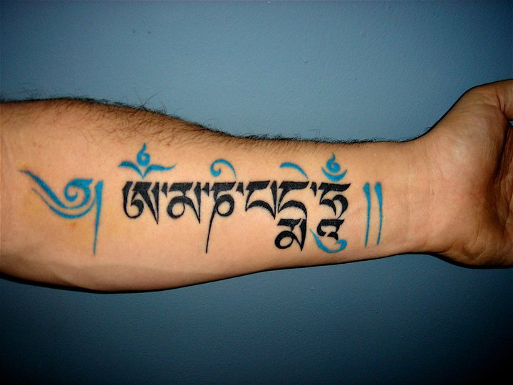 Colorful Arabic Tattoo On Forearm For Girls