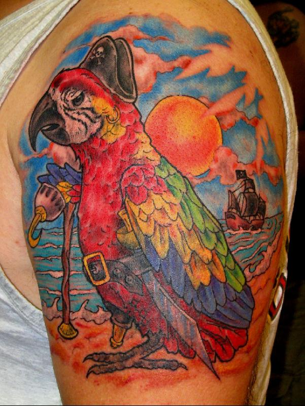 colorful traditional pirate skull tattoo on left shoulder
