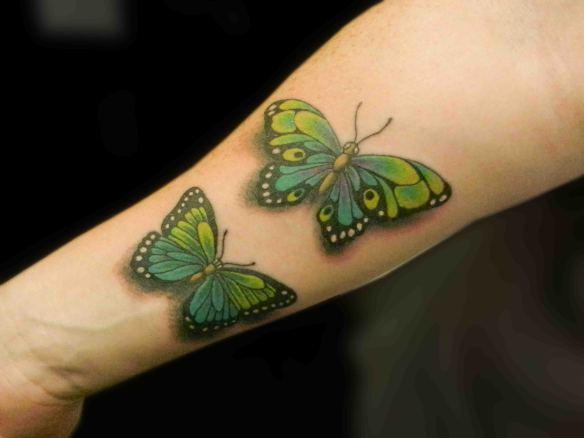 Cute 3D Green Ink Two Butterflies Tattoo On Forearm
