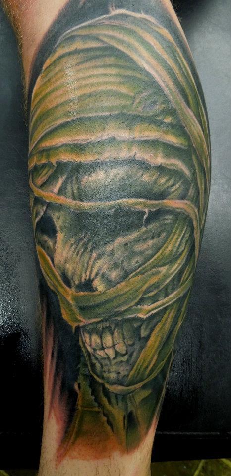 Green ink mummy tattoo on leg by aenema for Egyptian mummy tattoos