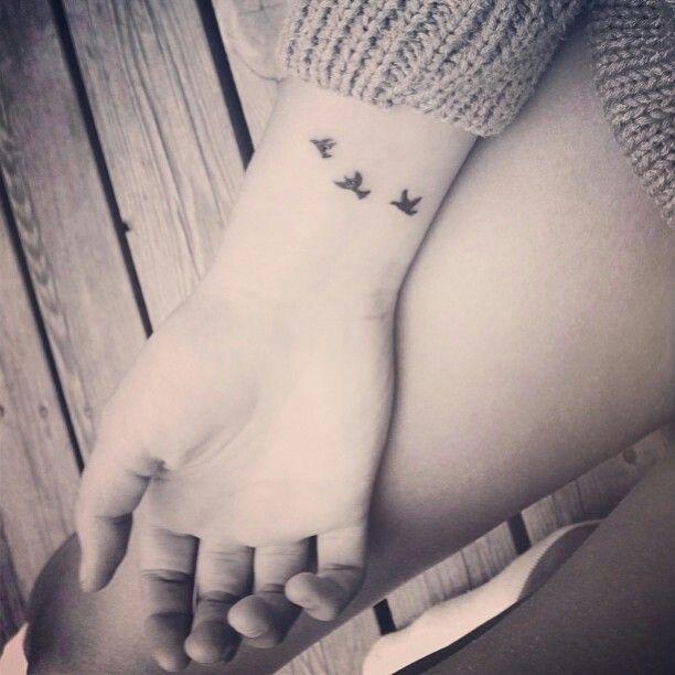 22dba8358 Nice Flying Birds Tattoo On Girl Right Wrist