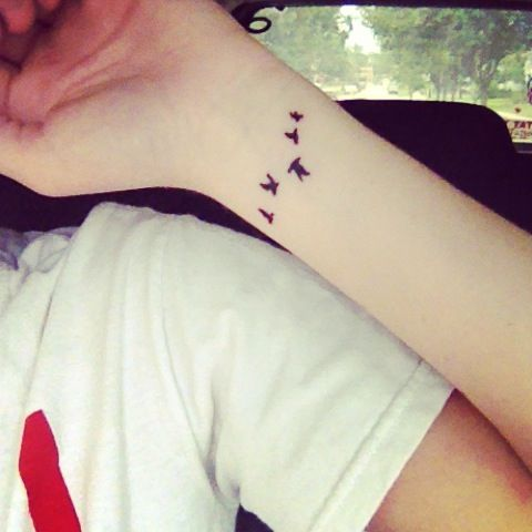 Nice Small Birds Tattoos On Left Wrist Dandelion Bird Tattoo On Side