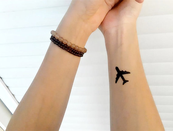 simple airplane silhouette tattoo