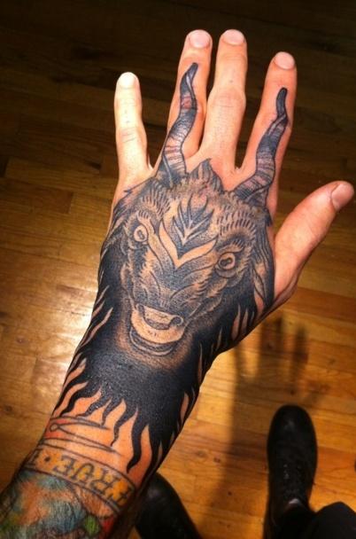 capricorn head tattoo on left hand. Black Bedroom Furniture Sets. Home Design Ideas