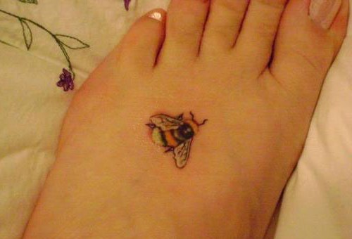 Little bee tattoo on girl foot for Small bee tattoo