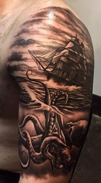 Black ink kraken monster attacking ship tattoo on man left half sleeve