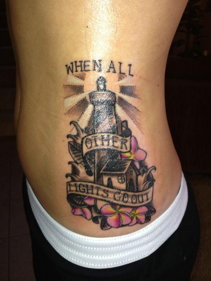 4  lighthouse tattoos on side rib