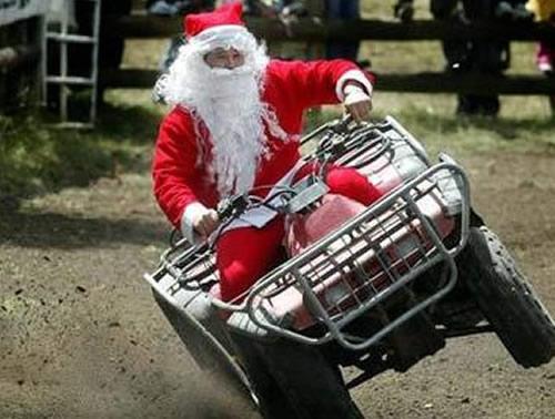 Funny Santa Driving Four Wheel Bike